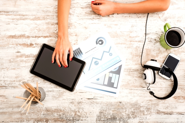 A young business woman working with the help of a tablet pc